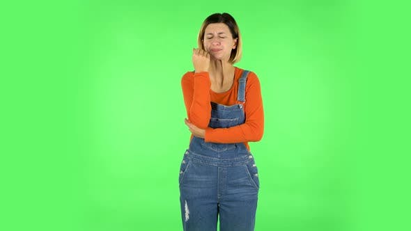 Thumbnail for Girl Got a Cold, Sore Throat and Head, Cough on Green Screen at Studio