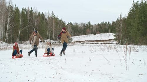 Young Couples Tobogganing