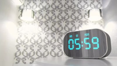 Alarm Clock in the Bedroom Ringing Loudly Early at the Morning