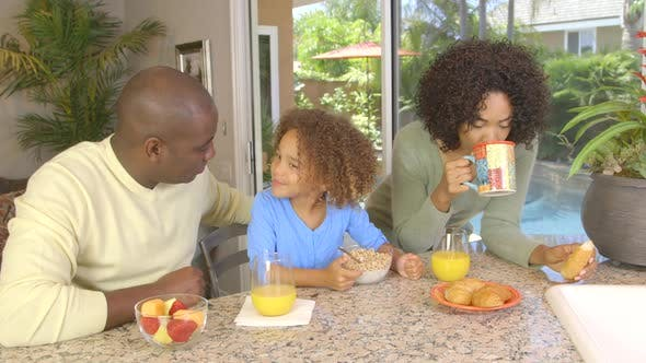 Thumbnail for African American family  eating breakfast