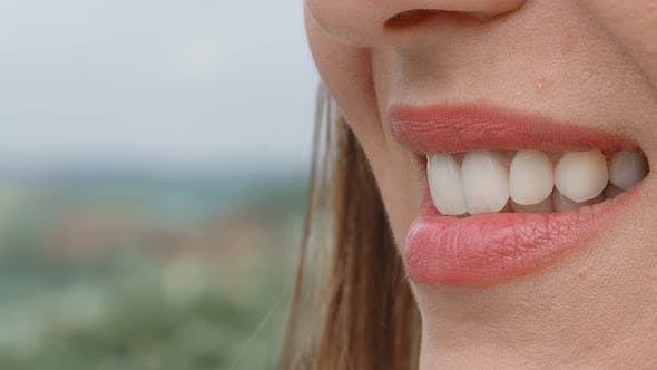 Smile of a Charming Girl with Perfect White Teeth Close Up Which Is Turned Sideways To the Camera