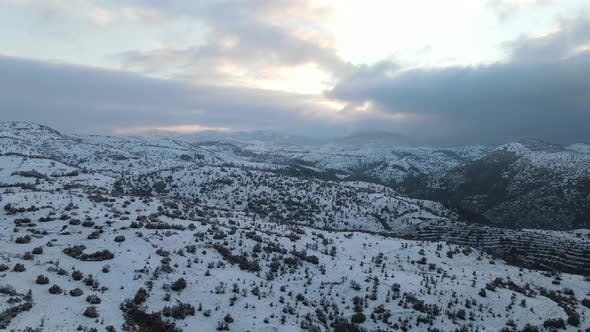Winter Forest High Mountains Covered with Snow Aerial View of the Snowy Hills