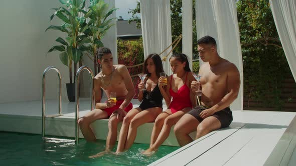 Thumbnail for Diverse People Drinking Cocktails at Pool Party
