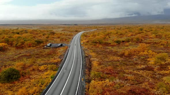 Aerial View of a Road Among the Autumn Icelandic Landscape, National Park Thingvellir