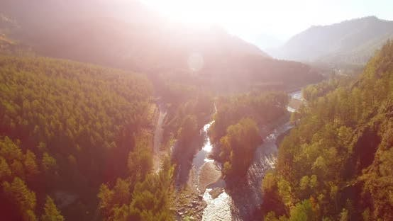 Thumbnail for Mid Air Flight Over Fresh Mountain River and Meadow at Sunny Summer Morning, Rural Dirt Road Below