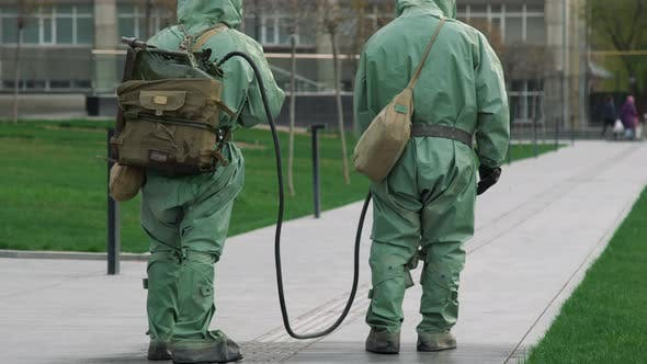 Thumbnail for People in bio viral hazard protective suits. Disinfection and decontamination on a public place