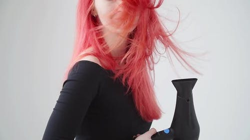 Beauty and Hair Care Concept. Young Woman with Red Hair Dries Hair