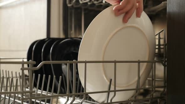 Thumbnail for Ceramic plates inside dish-washer slow motion 1920X1080 HD footage - Arranging of dishes inside dish