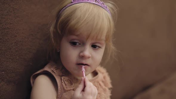 Thumbnail for Happy Three Years Old Girl. Cute Blonde Child. Brown Eyes. Girl Does Her Makeup