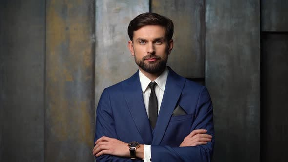 Cover Image for full hd video of young handsome stylish businessman wearing suit