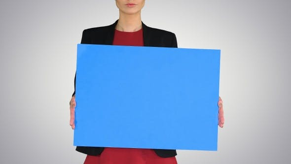 Thumbnail for Businesswoman Holding Blank Whiteboard Sign on Gradient Background