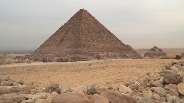 Pyramid of Menkaure in Giza. Camels at the foot of the pyramids