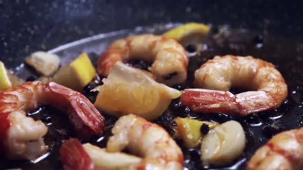Thumbnail for Large King Prawns Are Fried in a Pan in Olive Oil with Garlic