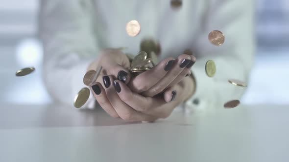 Thumbnail for Money Coins Falling Down Into Hands of Female