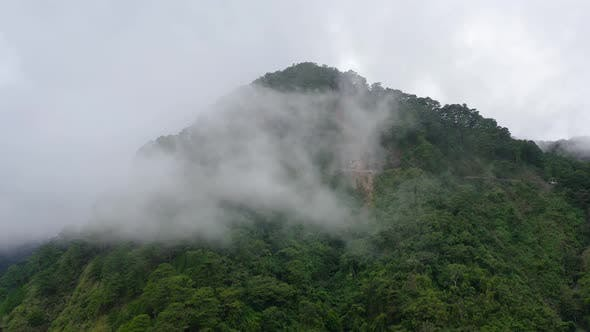 Mountain Peaks Are Covered with Rainforest and Clouds. Rain Clouds in a Tropical Climate.