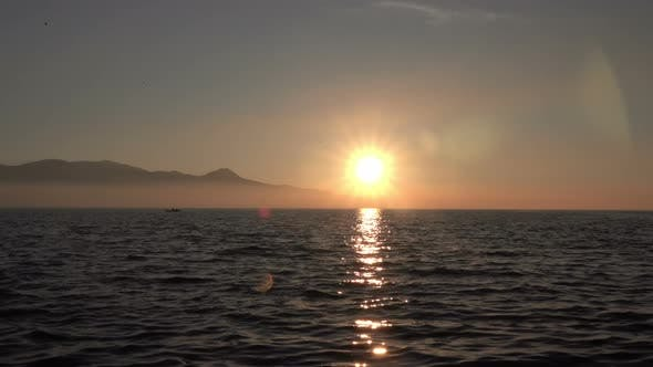 Sea Landscape At Sunset With Lens Flare