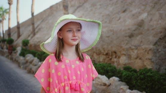 Portrait Happy Teenager Girl in Summer Hat Walking on Street Resort Hotel