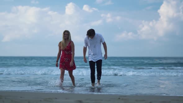 Thumbnail for Young Beautiful Couple Walking From the Sea in Wet Cloth