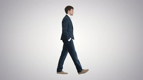 Cover Image for Handsome Business Man Walking with His Hands in Pockets on Gradient Background