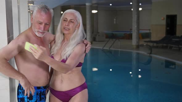Thumbnail for Joyful Old Couple Posing for Selfie By Hotel Pool