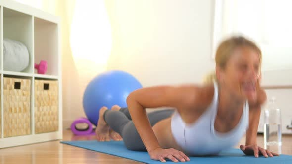 Thumbnail for Healthy blonde woman collapses and laughs while doing push ups