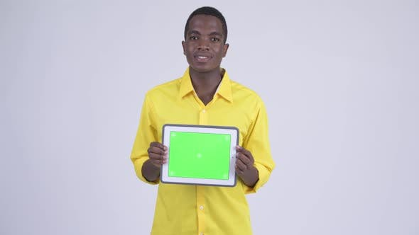 Thumbnail for Young Happy African Businessman Showing Digital Tablet