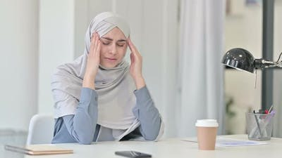 Young Arab Woman Feeling Worried While Thinking in Office