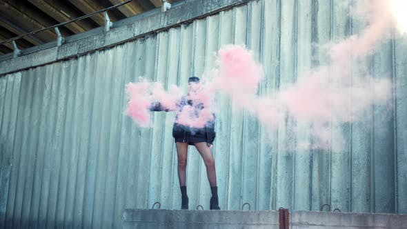 Thumbnail for Girl Standing on Street with Smoke Bomb in Hand. Woman Holding Smoke Grenade