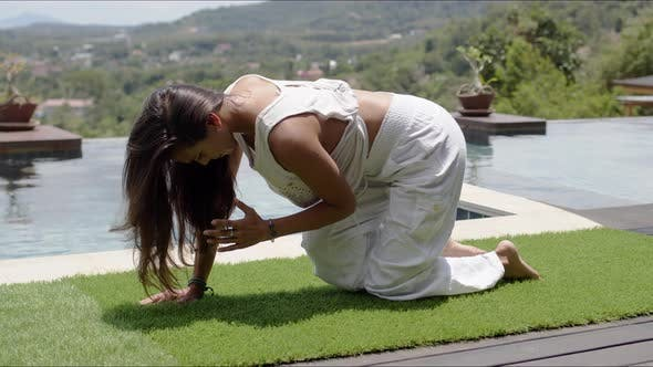 Thumbnail for Adult Woman Practicing Yoga Near Swimming Pool Against Landscape