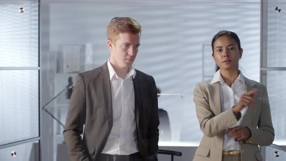 Thumbnail for Colleagues Using Invisible Touchscreen and Discussing Business in Office