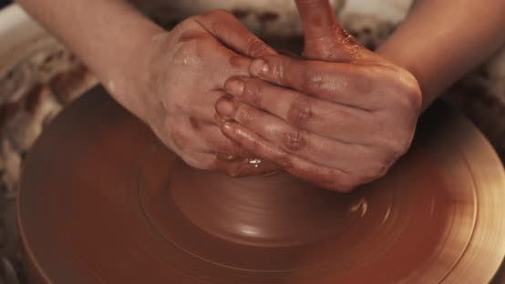 Thumbnail for Potter Makes Pottery From Clay Close Up. Making Ceramic Products From Red Clay. Twisted Potter's