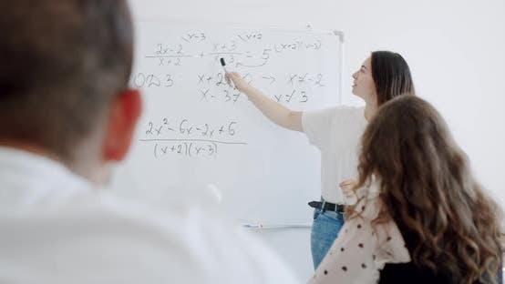 Thumbnail for Teacher Writes Math Formulas on Blackboard in School Classroom.
