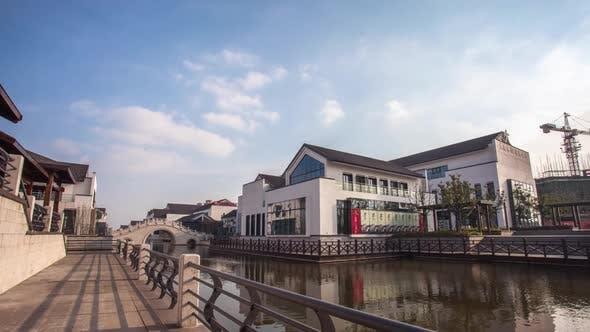 River, Bridge And Buildings