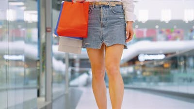 Sexy Woman Walking Along Shop Windows