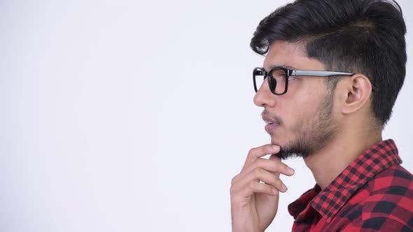 Thumbnail for Profilansicht von Young Handsome Bearded Indian Hipster Man Thinking