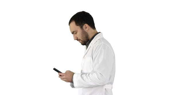 Thumbnail for Walking Doctor or Nurse Texting on A Cell Phone on White