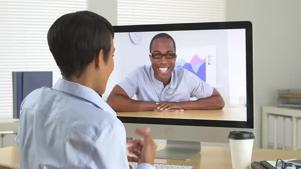 Thumbnail for Two African American business people chatting over internet