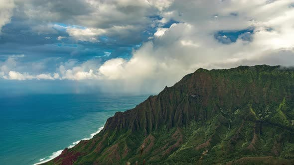 Cover Image for Wild Tropical Nature Time-lapse with Rainbow in Clouds at the Steep Mountains