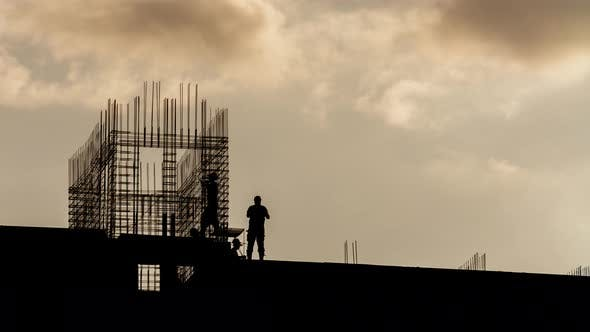 Thumbnail for Silhouette of Workers Working with Steel Rebar on Construction Site, Sunny Evening, Golden Hour