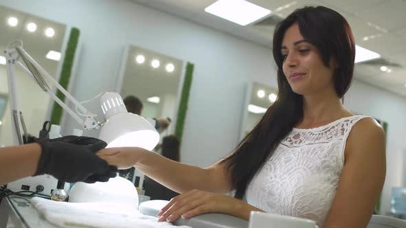 Cover Image for Charming Girl in a Manicure Salon