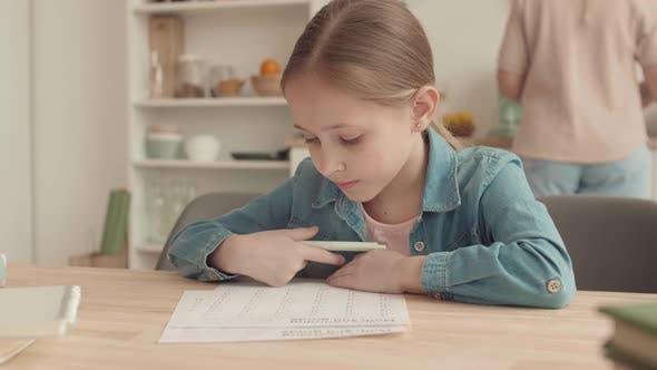 Thumbnail for Girl Doing Homework at Home