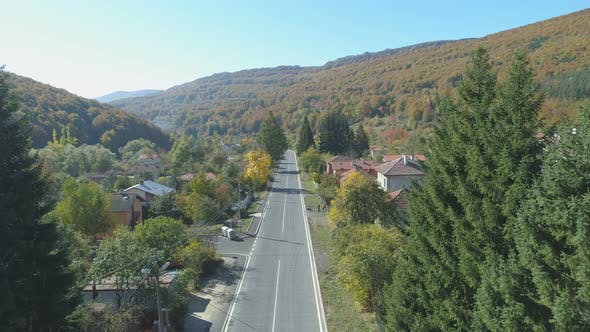 Thumbnail for Aerial View of Peaceful Road in the Small Mountain Village in Bulgaria