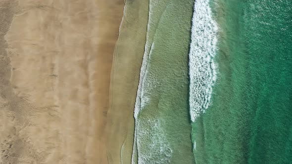 Top down view on the Lofoten beach and sea waves