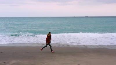 Boy with vest runs on the beach