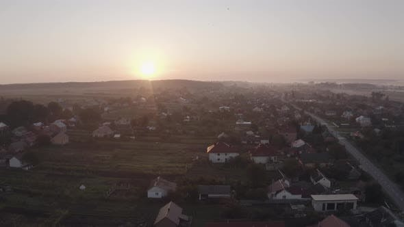 Thumbnail for Aerial Drone View Over Old Village at Sunrise. Swallows Birds Flying. Aerial Camera Bird Eye View