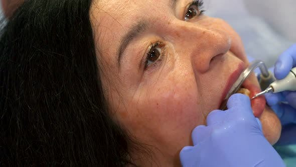 Woman Gets Deep Dental Cleaning