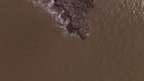 Thumbnail for Top Down shot of a Rocky Outcrop of an Island in the middle of the Ocean