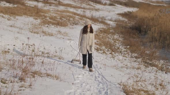 Thumbnail for Woman with Sled Outdoors