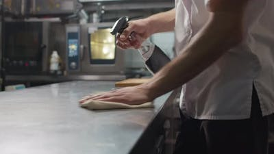 Chef Cleaning His Workplace With Disinfectant