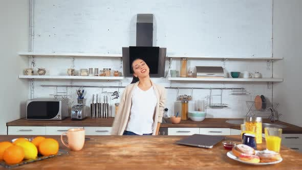 Thumbnail for Happy Woman Dancing in the Kitchen